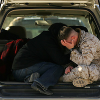 Crystal Chatham/The Desert Sun (-cq'd-)<br /> <br /> 01/27/2007 -- Corporal Dmitry Barkon, 21, right is hugged by his girlfriend Annette Trejo, 23, of West Covina inside the back of an SUV on Saturday, January 27 at 29 Palms Marine Corps Air Ground Combat Center before the departure of the 2nd Battalion, 7th Marine Regiment for a seven-month deployment in support of Operation Iraqi Freedom.