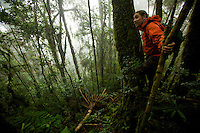 Edwin Scholes in the misty montane rain forest of the Arfak Mountains.
