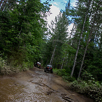 2 Polaris Rzrs on muddy trail in New England, rzr, mud, trees, blue sky, clouds, muddy, NH, New England, atv, utv, sxs, ohrv, orv, trail riding, hobby, adventure, sports, therapy, Click Stock Photography