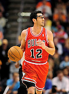 Nov. 14, 2012; Phoenix, AZ, USA; Chicago Bulls guard Kirk Hinrich (12) dribbles the ball up the court during the game against the Phoenix Suns at the US Airways Center. The Bulls defeated the Suns 112-106 in overtime. Mandatory Credit: Jennifer Stewart-USA TODAY Sports