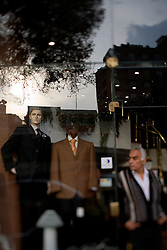A store front is seen in the wealthy neighborhood of Mohandessin in Cairo, Egypt, Dec. 21, 2005. Amr Khaled, the Islamic televangelist got his start here. Khaled, had previously been asked to leave Egypt as his revival gained strength. As a result he started preaching on several television shows, turning him into an international celebrity. Some religious scholars complain that Khaled has not been properly trained in Islam to command such a following.