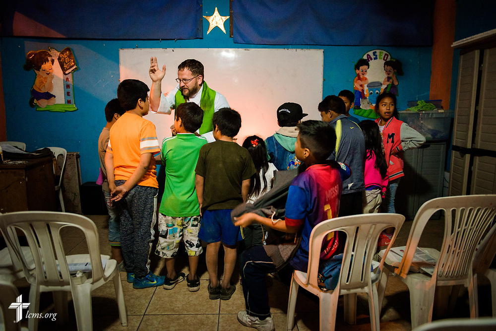 The Rev. Eddie Hosch, LCMS career missionary to Peru, blesses children during worship at the Castillo Fuerte site in San Juan de Lurigancho on Tuesday Nov. 7 2017, in Peru.  LCMS Communications/Erik M. Lunsford