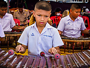29 OCTOBER 2018 - PHRA PRADAENG, SAMUT PRAKAN, THAILAND: School children perform on traditional instruments before the longboat races in Phra Pradaeng. The longboat races go about one kilometer down the Chao Phraya River to the main pier in Phra Pradaeng. The boats are crewed by about 20 oarsmen. Longboat racing traditionally marks the end of the Buddhist Rains Retreat (called Buddhist Lent) in Thai riverside communities.     PHOTO BY JACK KURTZ