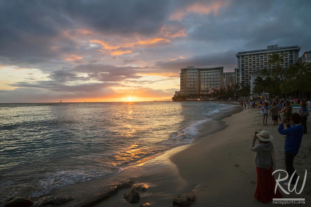 Tourists Watching Waikiki Beach Sunset, Honolulu, Oahu, Hawaii