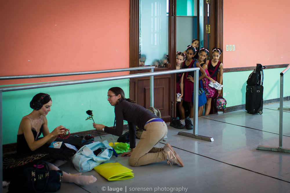 Viengsay Valdés of Ballet Nacional de Cuba in a dance studio of Escuela Nacional Cubana, Havana - with ballet kids looking through the door