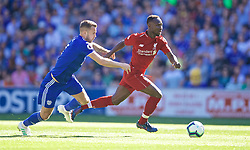 CARDIFF, WALES - Saturday, April 20, 2019: Liverpool's Naby Keita (R) and Cardiff City's Joe Ralls during the FA Premier League match between Cardiff City FC and Liverpool FC at the Cardiff City Stadium. (Pic by David Rawcliffe/Propaganda)