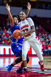 NORMAL, IL - January 03: Juliunn Redmond passes by Jasmine Elder on her way to the hoop during a college women's basketball game between the ISU Redbirds and the Sycamores of Indiana State January 03 2020 at Redbird Arena in Normal, IL. (Photo by Alan Look)