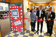 From left to right, Zanker principal Kathy Doi, MUSD School Board Representative Danny Lau, KLA-Tencor Vice President Oreste Donzella, and Mayor Jose Esteves cut the ribbon during the KLA-Tencor Computer Lab opening ceremony at Zanker Elementary School in Milpitas, California, on February 27, 2013. (Stan Olszewski/SOSKIphoto)