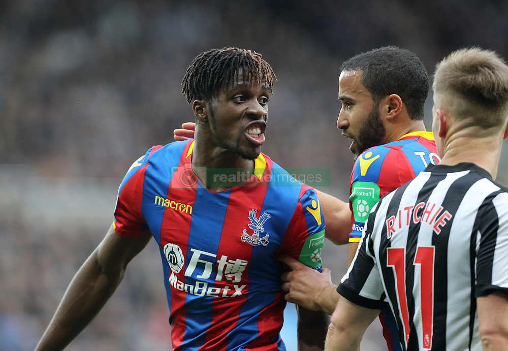 Crystal Palace's Wilfried Zaha reacts during the Premier League match at St James' Park, Newcastle.