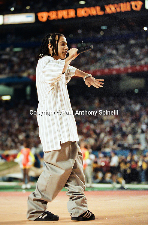 Singer Kris Kross sings as part of the pregame show before the Dallas Cowboys Super Bowl XXVIII NFL football game against the Buffalo Bills on Jan. 30, 1994 in Atlanta. The Cowboys won the game 30-13. (©Paul Anthony Spinelli)