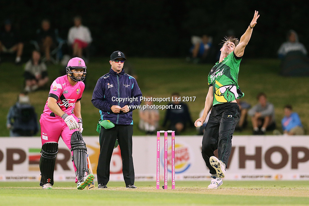 Stags Blair Tickner bowling as Knights Daniel Flynn backs up at the non-strikers end during the Burger King Super Smash Twenty20 cricket match Knights v Stags played at Bay Oval, Mount Maunganui, New Zealand on Wednesday 27 December 2017.<br /> <br /> Copyright photo: © Bruce Lim / www.photosport.nz