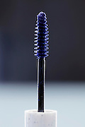 mascara brush with bleu purple makeup