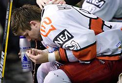 Injured Tomo Hafner of Acroni Jesenice at 38th Round of EBEL league  ice hockey match between HDD Tilia Olimpija Ljubljana and HK Acroni Jesenice, on January 1, 2010, in Arena Tivoli, Ljubljana, Slovenia. (Photo by Vid Ponikvar / Sportida)