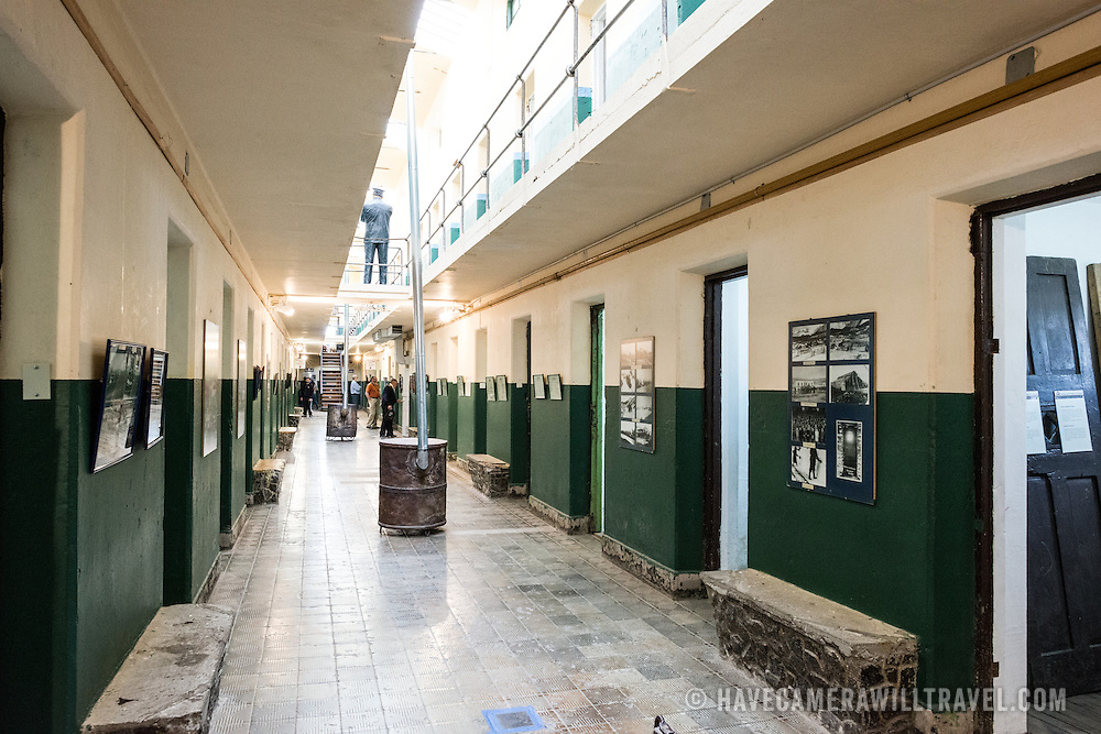 A corridor lined with cells at the Police and Penitentiary Museum that forms one part of the Maritime Museum of Ushuaia.