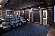 Media room in private home photographed for architect. Fiber optic ceiling lighting gives a sense of watching under the stars.