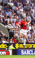 Fotball<br /> Premier League England 2003/2004<br /> Newcastle v Manchester United 23.08.2003<br /> Norway Only<br /> Foto: Digitalsport<br /> <br /> Photo. Jed Wee<br /> Newcastle United v Manchester United, FA Barclaycard Premiership, St. James' Park, Newcastle. 23/08/2003.<br /> Man Utd's Ole Gunnar Solskjær (R) and Newcastle's Andy O'Brien contest a high ball.