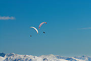 Paragliders flying above Hintertux, Zillertal, Austrian alps