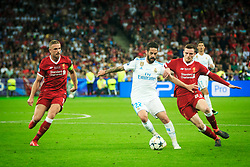 Isco of Real Madrid between Jordan Henderson and Andy Robertson of Liverpool during the UEFA Champions League final football match between Liverpool and Real Madrid at the Olympic Stadium in Kiev, Ukraine on May 26, 2018.Photo by Sandi Fiser / Sportida