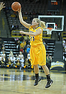 December 20, 2011: Iowa Hawkeyes guard Melissa Dixon (21) passes the ball during the NCAA women's basketball game between the Drake Bulldogs and the Iowa Hawkeyes at Carver-Hawkeye Arena in Iowa City, Iowa on Tuesday, December 20, 2011. Iowa defeated Drake 71-46.