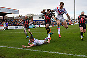 Max Jowitt (21) of Wakefield Trinity, Tom Johnstone (2) of Wakefield Trinity and Jake Mamo (17) of Warrington Wolves during the Betfred Super League match between Wakefield Trinity Wildcats and Warrington Wolves at Belle Vue, Wakefield, United Kingdom on 16 February 2020.