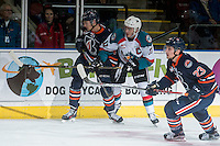 KELOWNA, CANADA - DECEMBER 27: Rodney Southam #17 of the Kelowna Rockets checks the Kamloops Blazers during first period on December 27, 2016 at Prospera Place in Kelowna, British Columbia, Canada.  (Photo by Marissa Baecker/Shoot the Breeze)  *** Local Caption ***