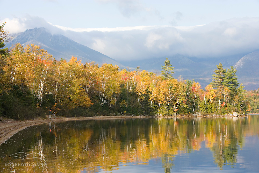 Painter on the shore of Katahdin Lake near Baxter State Park Maine USA