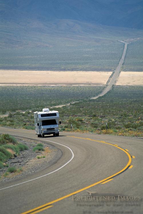 Camper RV on asphalt desert highway 190 through Panamint Valley, Death Valley National Park, California