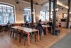 © Licensed to London News Pictures. 17/03/2020. London, UK.  Seven Dials Market food halls are empty of customers at lunchtime as the Coronavirus outbreak spreads . Photo credit: Ray Tang/LNP