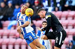 James Vaughan of Wigan Athletic challenges Harrison McGahey of Rochdale - Mandatory by-line: Robbie Stephenson/JMP - 24/02/2018 - FOOTBALL - DW Stadium - Wigan, England - Wigan Athletic v Rochdale - Sky Bet League One