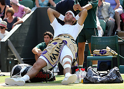 Dejected Juan Martin Del Potro  during his loss in the semi-final at the Wimbledon Tennis Championships in London, Friday, 5th July 2013<br /> Picture by Stephen Lock / i-Images