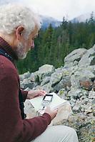 Man using a compass outdoors&#xA;<br />
