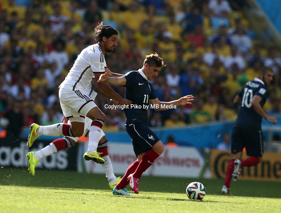 Fifa Soccer World Cup - Brazil 2014 - <br /> FRANCE (FRA) Vs. GERMANY (GER) - Quarter-finals - Estadio do Maracana Rio De Janeiro -- Brazil (BRA) - 04 July 2014 <br /> Here German player Sami KHEDIRA (L) is cautioned. Foul over French player Antoine GRIEZMANN (R)<br /> &copy; PikoPress
