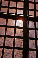 Visual effects of the sun through a wire mesh window in Arles, France.