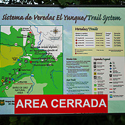 RIO GRANDE, PUERTO RICO -- FEBRUARY 1, 2019: <br /> A sign with a red sign announcing a closed area of El Yunque National Rain Forest. A few of the rain forest's popular trails and attractions are still not open to the public more that one year after Hurricane Maria's path through Puerto Rico.<br /> (Photo by Angel Valentin)