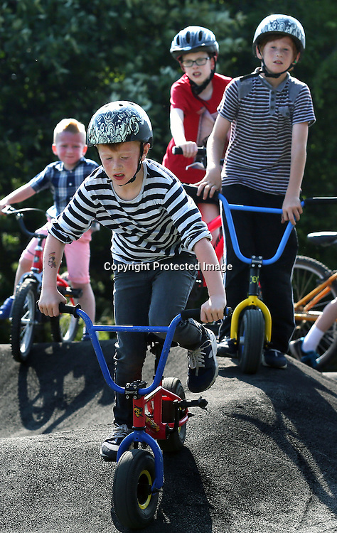 Children in the bike park at Cuningar Loop woodland park.23.08.2015.Photo David Cheskin