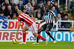 Moussa Sissoko of Newcastle United is challenged by Wes Brown of Sunderland - Photo mandatory by-line: Rogan Thomson/JMP - 07966 386802 - 21/12/2014 - SPORT - FOOTBALL - Newcastle upon Tyne, England - St James' Park - Newcastle United v Sunderland - Tyne-Wear derby - Barclays Premier League.