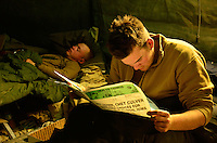 101210-N-6436W-010<br /> KHAVAJEH MOLK, Afghanistan-- Exhausted Seabees enjoy a little downtime in a small tent. Active and reserve component Seabees from Naval Mobile Construction Battalions 40, 18 and 26 as well as the Army 1st Battalion 66th Armored Regiment who are working together to fortify and secure a remote combat outpost (COP) on the eastern edge of small village named Khavejeh Molk, Afganistan. The village is located approximately 25 miles north of Kandahar City and is being used as a patrol base for the US Army 1st Battalion 66th Armored Regiment. The combination efforts by joint forces will restrict movement of Taliban insurgents and help secure the self-governing efforts in Afghanistan. US Navy photo by Chief Mass Communication Specialist Michael B. Watkins