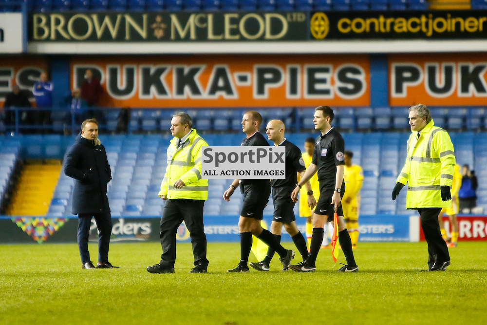 Carlos Carvalhal stares at Referee Darren Handley as they are escotted off the pitch during Sheffield Wednesday v Milton Keynes Dons, SkyBet Championship, Tuesday 19th April 2016, Hilsborough, Sheffield