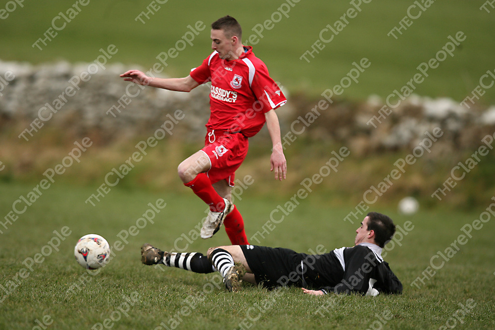 Moher's Caoimhin Phillips tries to get the ball away from Lifford's Scott Hennessy during their game in Liscannor on Sunday morning.<br /> Photograph by Yvonne Vaughan