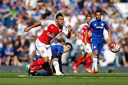 Francis Coquelin of Arsenal is challenged by Oscar of Chelsea - Mandatory byline: Rogan Thomson/JMP - 07966 386802 - 19/09/2015 - FOOTBALL - Stamford Bridge Stadium - London, England - Chelsea v Arsenal - Barclays Premier League.