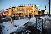 Snow and a parking lot sign frame the foreground as Lincoln Financial Field stands tall in the background before the Philadelphia Eagles NFL NFC Wild Card football game against the New Orleans Saints on Saturday, Jan. 4, 2014 in Philadelphia. ©Paul Anthony Spinelli