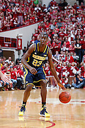 BLOOMINGTON, IN - FEBRUARY 2: Caris LeVert #23 of the Michigan Wolverines handles the ball against the Indiana Hoosiers during the game at Assembly Hall on February 2, 2014 in Bloomington, Indiana. Indiana defeated Michigan 63-52. (Photo by Joe Robbins)