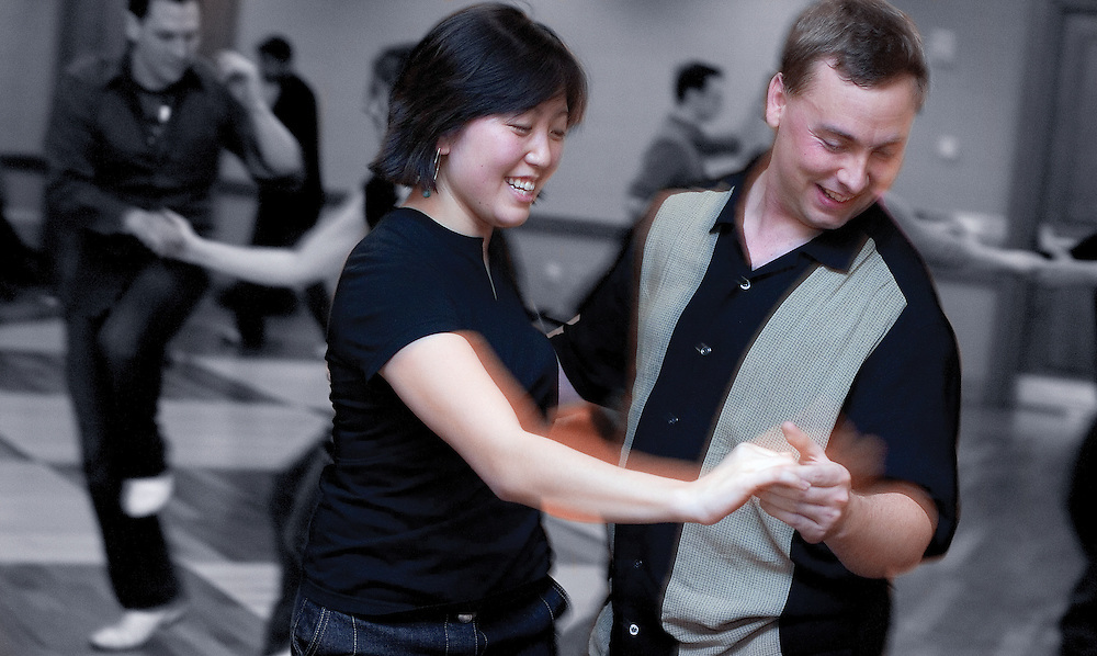 O.U. Jitterbug Club member Bethan Eynon (right) dances with Patrick Miller during a Jitterbug Club dance at Baker Center on Friday, 2/23/07.