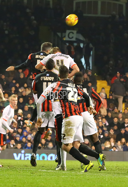 4., Aaron Hughes coming on and winning 1st header to protect Brightons lead during the Sky Bet Championship match between Fulham and Brighton and Hove Albion at Craven Cottage, London, England on 29 December 2014. Photo by Matthew Redman.