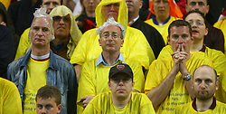 PARIS, FRANCE - WEDNESDAY, MAY 17th, 2006: Arsenal fans, drenched from the Parisian downpour of rain, look dejected as FC Barcelona score the winning goal during the UEFA Champions League Final at the Stade de France. (Pic by David Rawcliffe/Propaganda)