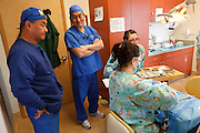 Peter Chiang, D.D.S., left, and Kenji Saisho, M.D., D.D.S., chat Tuesday, Dec. 13, 2011, at Central Coast Pediatric Dental Group in Salinas, California.