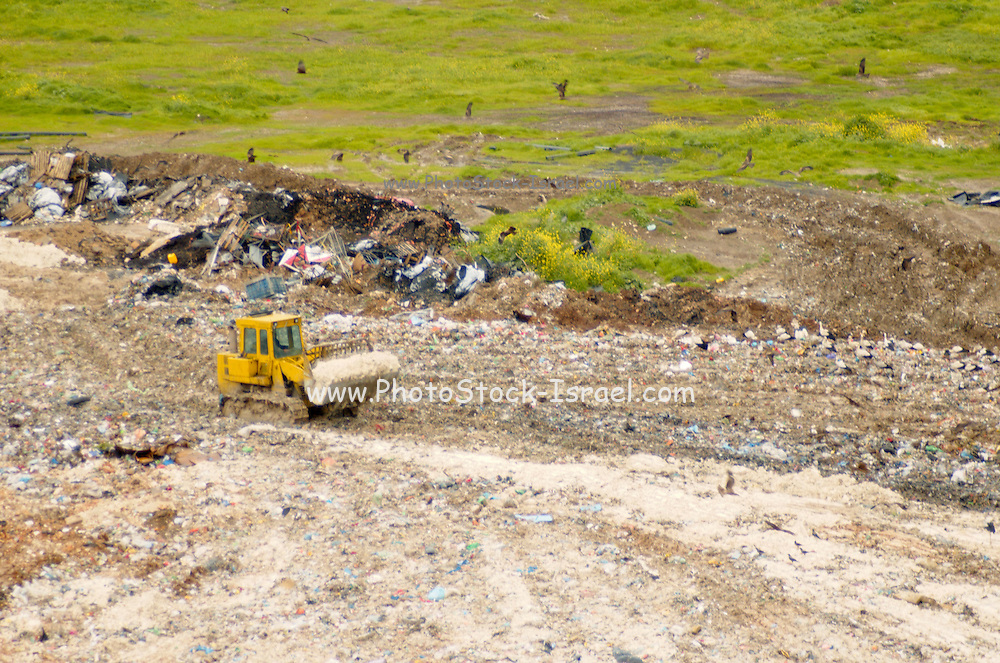 Landfill site Israel upper galilee, tractor working on site