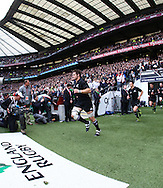 Richie McCaw of New Zealand leads his players onto the field before the Investec series international between England and the New Zealand All Blacks at Twickenham, London, Looks on Saturday 6th November 2010. (Photo by Andrew Tobin/SLIK images)