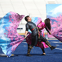 Armando Hernandez, left, and Chloe Smith of Mooreville High School's Color Guard perform Saturday for the Band Competition held at Tupelo High School