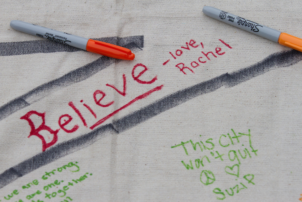 Messages on a canvas banner are pictured during a vigil for the victim's of Monday's terrorist bombings near the finish line of the Boston Marathon, on Boston Common in Boston, MA on Tuesday, April 16, 2013.  (Matthew Cavanaugh for The Washington Post)